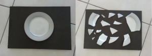 A plate is glued to one side of a board, on the other side are the broken pieces of an identical plate. This was to illustrate how statistics can teach you about initial conditions (like the composition of the plate for example) as an analogy to how the statistics of galaxies teach us about the early Universe.